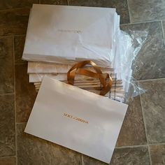 Bundle of15 authentic Dolce & Gabbana shopping bag Is a brand new never used and they're all individually wrapped except for the one I pulled out to show these are very nice thick heavy bags. All real 100% authentic firm price. Posh takes 20% from me. No discount at all Dolce & Gabbana Bags