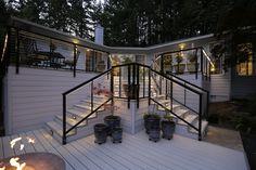 Black cable railings by Nexan. Light grey Nextdeck aluminum decking.