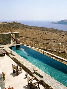 Beautiful rustic pool. Picking coping and rocks to blend in with the surrounding landscape really makes this pool fit in and not look out of place.  Villa Drakothea Greece