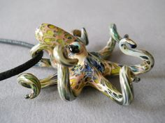 Amazon spotted octopus pendant for guy or gal    Glass artist use this method to get a special effect that you see in this Octopus pendant, which