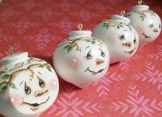 Handpainted Christmas ornaments, round snowman faces painted on wooden turnings. These guys are so cute peeking out from your Christmas tree branches! One has a flat side where Ive painted his face. The rest are round, with a gold eye screw at the top and white ribbon to hang them from. I took these pictures before I added the ribbon, but its there now! these would be so sweet on your tree or would be great gifts for a friend or colleague. Wonderful little item for a Christmas gift exchange…