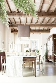 Rustic dining room with exposed ceiling beams