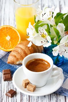 cup of coffee and breakfast   Stock image of 'Cup of coffee and fresh croissant for breakfast.'