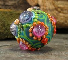 by flamekeeper -Love love love her work! I just want to keep collecting them and put them in a bowl like marbles!