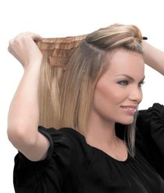 """Reflecting the latest in clip-in extension technology, this 16in piece features hair that is stitched to a thin polyurethane layer, resulting in a lighter, thinner, virtually undetectable piece that lays flat to the head for a more comfortable, natural look.   Available in 11 Salon inspired colors.   16"""" Fineline Extension How-To Video"""