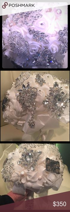 Elegant white jeweled brooch bouquet Elegant white wedding bouquet with large crystal brooches all over. White silk ribbon and bows adorn the bouquet. Pearls and rhinestones pins finish off the bouquet. Heavy mirrored diamond shaped trim finish the bottom of the handle which is wrapped in white silk ribbon custom  Jewelry Brooches