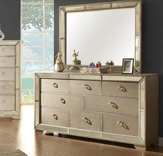 Loraine Dresser CM7195This is what luxury feels and looks like. The padded leatherette headboard and footboard are beautifully complemented by antique mirror borders, which are also found on the case goods' front panels. Stylish details like the nailhead trim, button tufting, ring drawer pulls, and silver gray finish all add polish to this sophisticated bedroom set.Features:Modern Victorian StyleButton Tufted Leatherette H/B