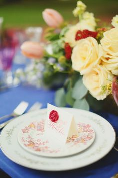 Scarlet, blue, and yellow place setting | J. Woodbery Photography | see more on: http://burnettsboards.com/2014/09/classic-southern-wedding-inspired-wind/