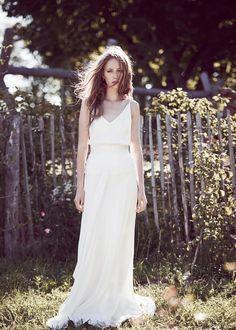 Robe de mariée longue drapée.
