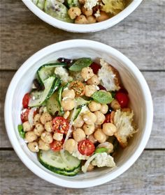 little bowl of panzanella - greens, cucumbers, chick peas, tomatoes, feta, olives, onions