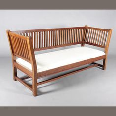 A mahogany frame settee in the manner of Gustav Stickley, probably by Liberty & Co., circa 1900