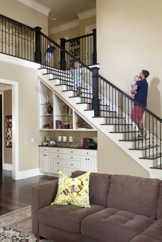 Khaki walls, dark brown wood, black accents (staircase). I love this but would probably want a back stairway as well.