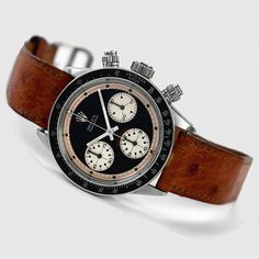 Rolex Daytona Paul Newman Cosmograph    If ever I were to purchase a stupidly expensive watch, this would be the one.