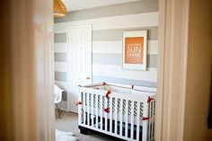 grey and white stripes in the nursery, with orange