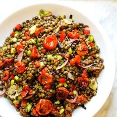 This Roasted Garlic & Tomato Lentil Salad is the perfect vegan cold lentil salad that everyone will love! With roasted garlic, oven roasted tomatoes and onions, this is one you don't want to miss.