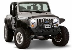 These flat fender flares from Bushwacker provide additional head room for larger tires, a necessity during a good crawl session: http://www.autoanything.com/fender-flares/73A5149A0A0.aspx