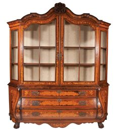 Exceptional Dutch walnut bonnet top display cabinet with bombe shaped base on ball and claw feet with satinwood marquetry inlay, arched…