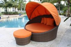 Barbados Patio Orbital Daybed With Canopy and Ottoman from Pelican Reef!!  This contemporary patio set has a fully anodized aluminum frame, and woven polyethylene materials, that are unique due to the textured surface. The Barbados Collection does not require cushions. The collection also features frosted tempered glass on all its tables, along with the ability to accommodate an umbrella with the patio dining set.