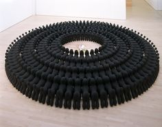 """Katharina Fritsch """"Kind mit Pudeln"""" (Baby with Poodles)  I saw this a few years ago at SFMoMA.  It was amazing.  Took up a whole gallery.  224 black poodles surrounding a baby.  The size and number make you feel they're perhaps threatening -- OR -- could they be protecting the baby?  Is it safe or in danger?  Recalls Goethe's story of Faust when he sees a black poodle and takes it home, only to discover it's the devil.  Awesome art."""