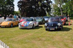 Porsche 356 next to 911s