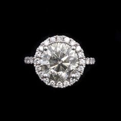 A women's ctw white gold engagement ring. This ring features a carat round brilliant natural cut center diamond stone. The diamond is graded O-P color with a faint grey color and 3 Carat, Diamond Stone, Fashion Accessories, Sapphire, Gems, Engagement Rings, Crystals, White Gold, Sparkles