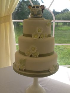 White and Sage Green Wedding cake with Campervan Topper by…