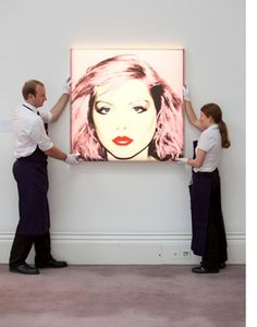 Andy Warhol's Debbie Harry is hung in preparation for the exhibition of the Contemporary Art evening sale in London #sothebysatauction