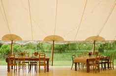 nice use of chairs, table coverings, classic tent