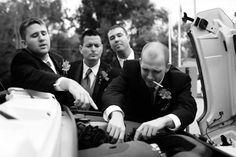 Groomsmen broken down car. Fun wedding photos