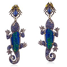 These beauties are a one of a kind whimsical design. The lizards appear to be chasing the spiders at the top of the earring. I don't know what happens if they catch them!0.75 cts diamonds1.99 grams gold 8.47grams silver3.43 cts Blue Shapphire7.6 cts Opal Doublet12.82 gross weight61x20 mm