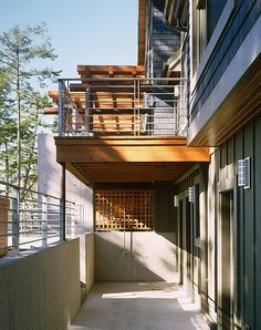 Bomgardner Residence layered modern front porch with steel columns and railings and wood trellis - Pelletier + Schaar