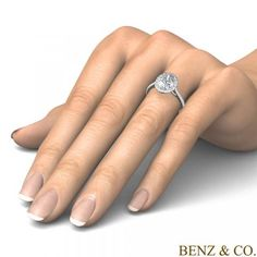 Floating Halo Diamond Engagement Ring - The result is a refined and feminine design that allows greater light flow into the diamond, enhancing its brilliance and gives it a bigger look. Setting includes at least 0.42 carat total diamond weight.