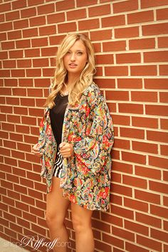 OVERLAY + STRIPES One of our favorite trends for early fall is the overlay with patterned shorts. We went even more bold with today's look by featuring a floral overlay with striped shorties. It could potentially be too busy, but the simplicity of the black and white stripes are a perfect contrast to the bright floral print! This outfit is also ideal for changing weather because it allows you to dress in layers. Shop Caroline's entire look today on www.shopriffraff.com!