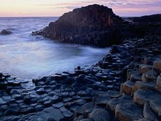 12 Unusual Beaches You Won't Believe Exist. Giant's Causeway. Antrim, Northern Ireland. The studded beach known as Giant's Causeway, a UNESCO World Heritage Site, is made up of polygonal columns of basalt protruding from the coast and water. They were caused by a volcanic eruption 60 million years ago, but one local legend claims that the columns were carved by a giant named Finn McCool (hence the name).