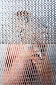 People Behind Perforated Screen-2