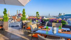 No better way to enjoy than basking in the sun with views of on The China Moon Roof Terrace at Mandarin Oriental, Munich! Hotel Gast, Grand Parc, Wooden Patios, Best Rooftop Bars, Roof Architecture, Pergola Attached To House, Terrace Design, Mandarin Oriental, Patio Roof