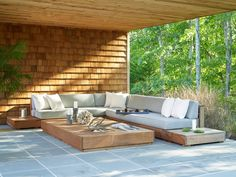Beach Style Patio by Living Wood Design