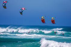 RRD squad taking over this wave on 2015 Religion kites. RRD kiteboarding and kitesurfing wallpaper.