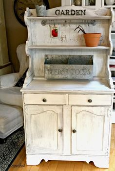 I would love to find an old hutch like this one to use on my front porch to put some of my potted plant on during winter and help keep them from freezing.