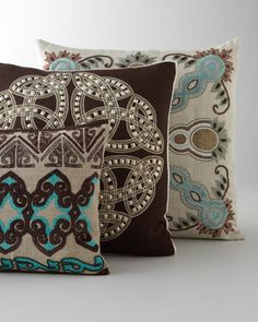 """Applique and Beaded Pillows    Dress up any decor with these finely embroidered and elegantly accented applique pillows.  Handcrafted of linen, viscose, and velvet with accent beading.  Pillows have feather/down fill.  Long turquoise and brown pillow, 31"""" x 14"""".  Square white bead pillow, 22""""Sq.  Square turquoise bead pillow, 22""""Sq.  Dry clean.  Imported."""
