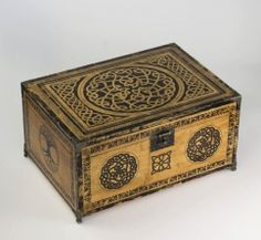 Wooden box carved with Celtic knot motifs would be a unique way for a ring-bearer to present the rings during the ceremony