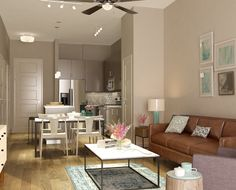 Camel colored couch and patterned pillows add dimension to the living room at 555 Ross Avenue Apartments in Dallas, TX.