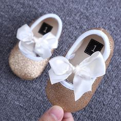 Watching your baby take her/his first steps is an exciting milestone for you and her. And now that she's/he's cruising, you may want to consider purchasing his/her first pair of shoes. Shoes should be