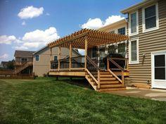Cedar pergola with composite decking and aluminum balusters