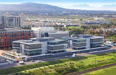 Sable Park comprises two four-storey buildings of and respectively with two levels of underground parking. The buildings are each split into two wings with a central core and full height atrium bringing light into the centre of the expansive floor plates. Table Mountain, Commercial Design, Atrium, San Francisco Skyline, Architects, Facade, Centre, Buildings, Wings