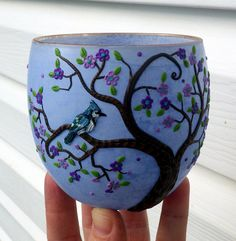 Bluejay sits in a Purple Spring Blossom Tree Sculpted with Polymer clay onto a Periwinkle Blue Recycled Glass Candle Holder