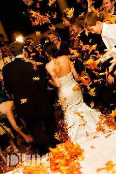 For a fall wedding - guests throw leaves instead of confetti - D. Jones Photography