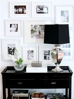 A black & white cluster of Family Photos...Beautiful Entryway Idea.