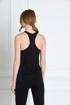 MARIA BLACK TANK - A faultless fit and soft, non-toxic jersey material make the Maria Tank a must have. The scooped racer back and high neckline front are impeccably assembled with bonded seams. A multipurpose piece, it can be worn from the markets to the Yoga mat, with many a tea date in-between