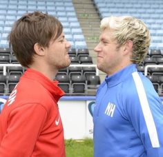 "Louis looks so cute trying to look tough and then Niall like ""dont laugh, gotta be serious"""